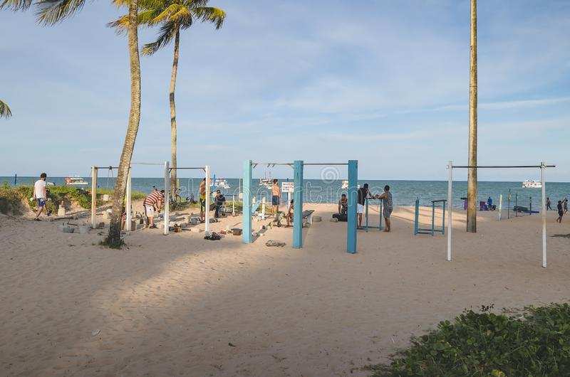 Bodybuilding gym at the beach sand of Tambau. Joao Pessoa - PB, Brazil - February 21, 2019: Open air gym in front of the Tambau beach. People doing exercises at stock photos