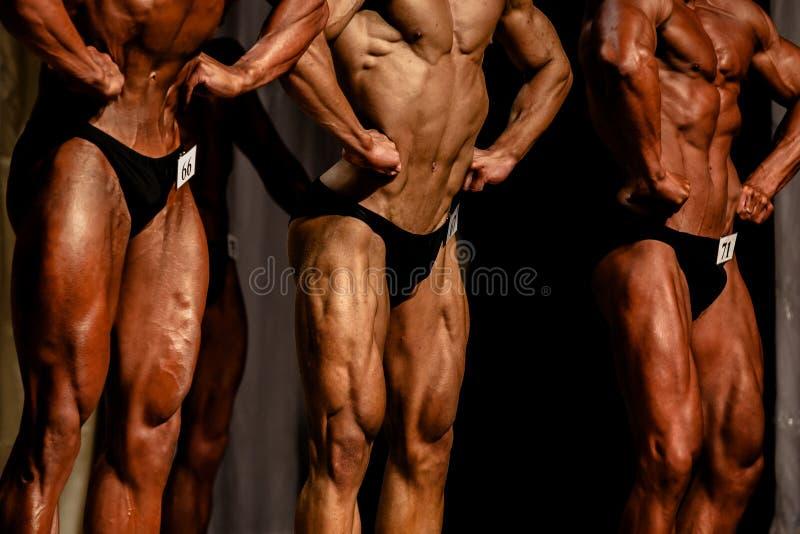 Bodybuilding rywalizacje trzy atlety zdjęcie royalty free