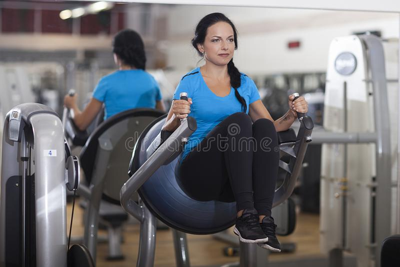 Bodybuilding. woman exercising in gym abs legs up. Bodybuilding. woman exercising in gym abs legs up royalty free stock photography