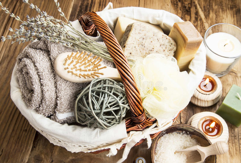 Bodycare Products in a Wicker Basket. With Homemade Soap and Soft Towel over Wooden Background stock photos