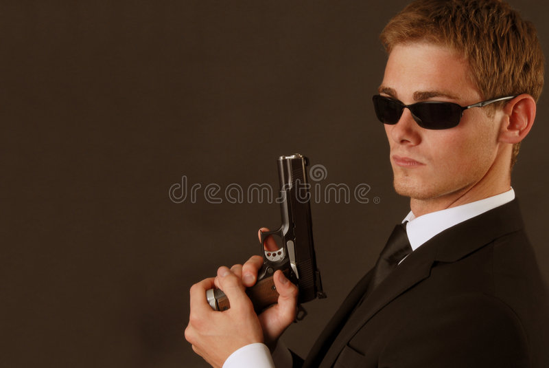 Bodygard met een pistole royalty-vrije stock foto's