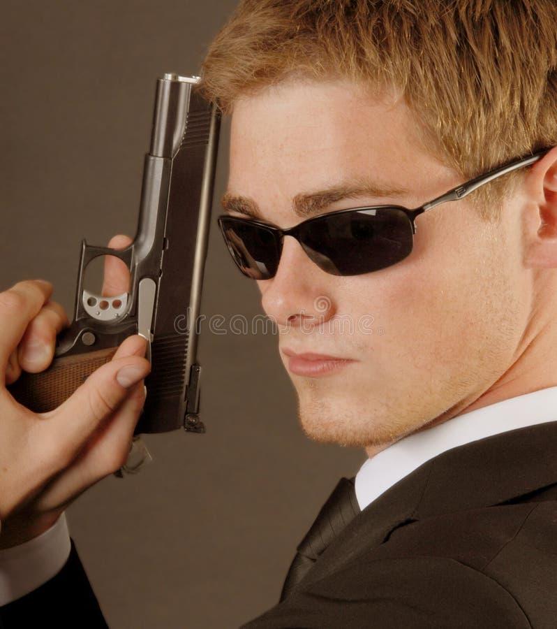 Bodygard met een pistole royalty-vrije stock fotografie