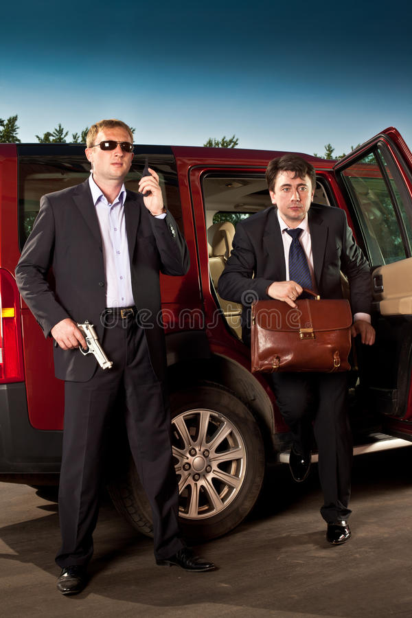 Bodyguard and its boss. Leave the car royalty free stock image