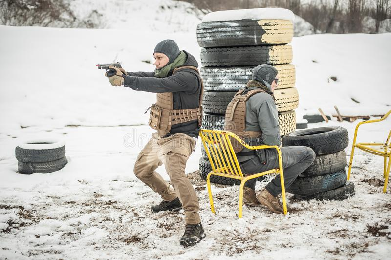 Bodyguard and VIP people security protection. Combat gun shooting training stock photography