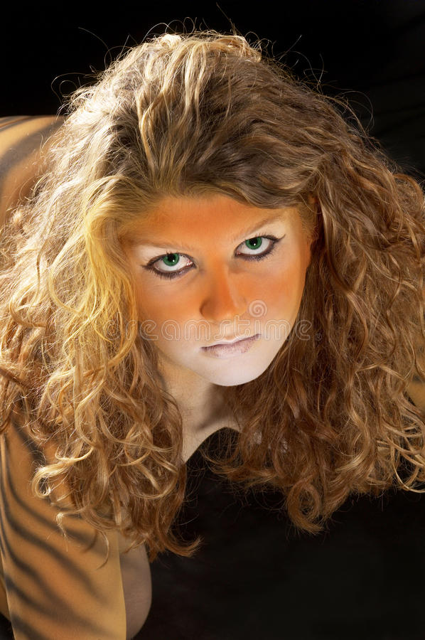 Bodypainted tiger girl portrait stock photography