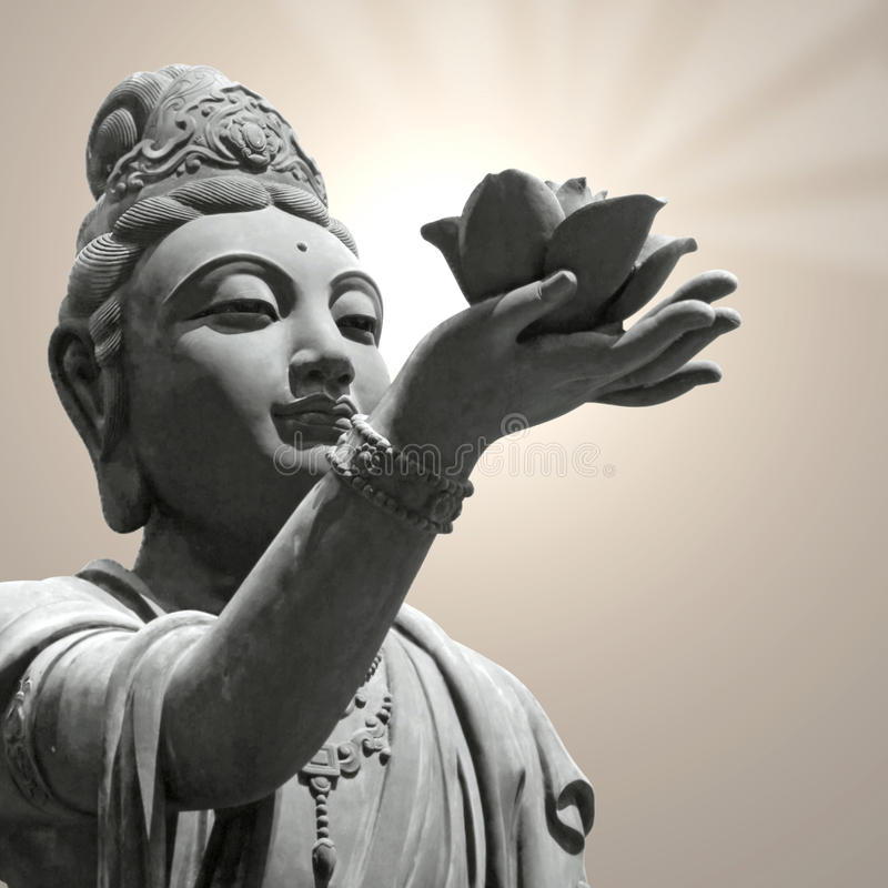 Boeddhistische de lotusbloembloem van de standbeeldholding stock afbeeldingen