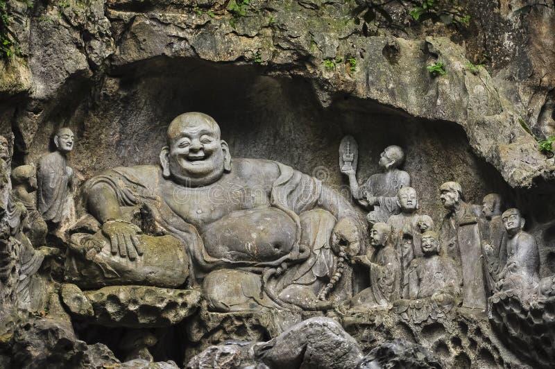 Boeddhistische gravures in de Holen van Feilai Feng stock afbeeldingen