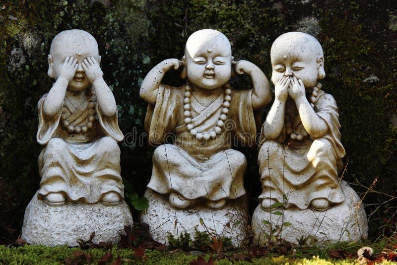 Boeddhistische standbeelden stock afbeeldingen
