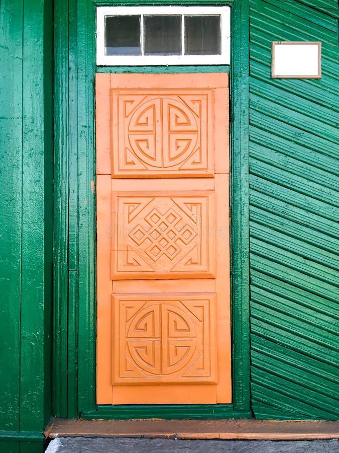 Boeddhistische symbolen op de deur royalty-vrije stock foto