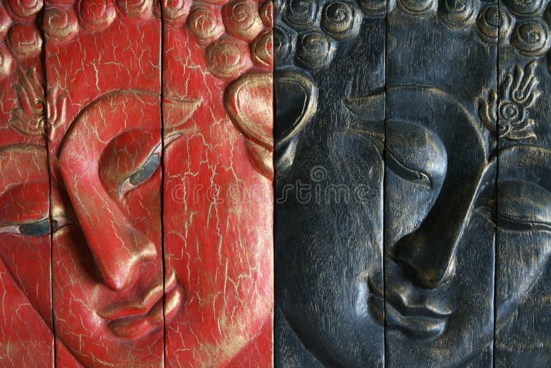 Boedha - rood en blauw stock fotografie