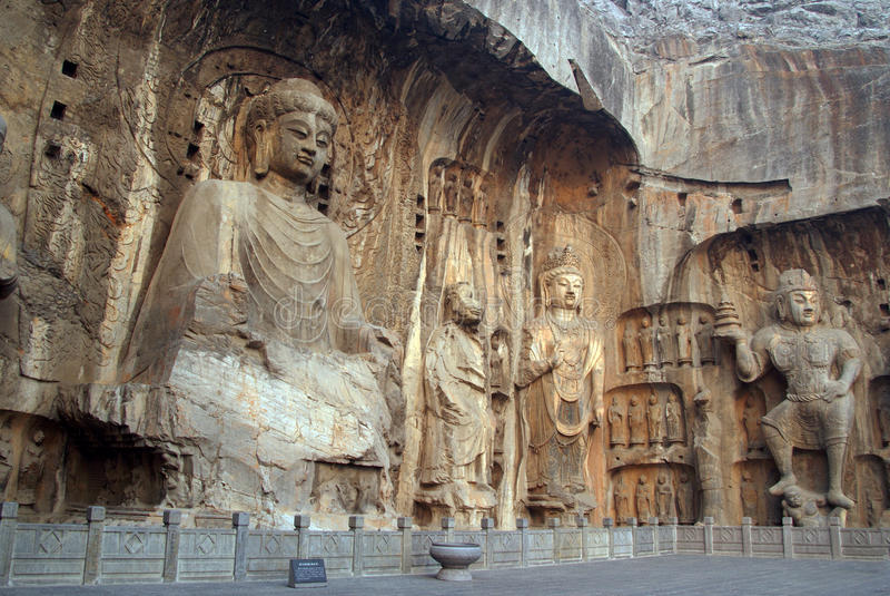 Boedha statues at Longmen caves in China. Boedha Vaironaca and other statues at Longmen caves in China stock photo