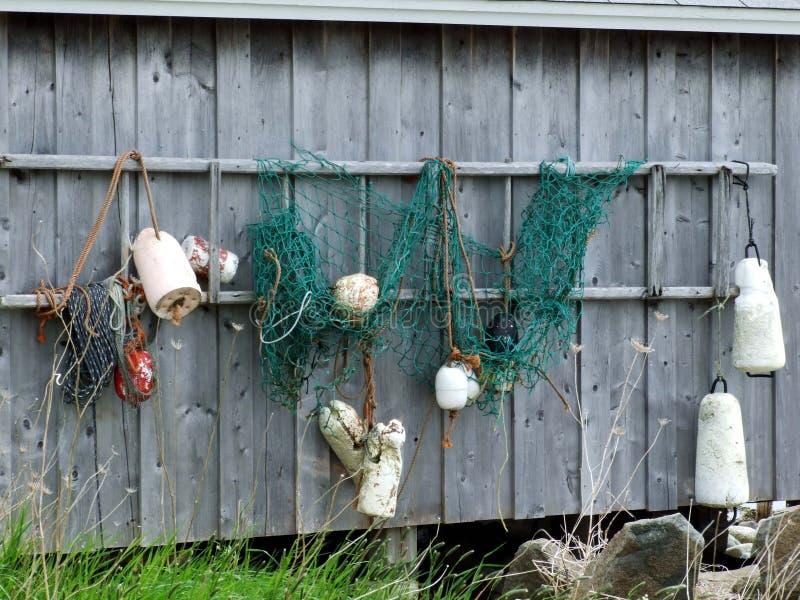 Boeien die op vissenkeet hangen royalty-vrije stock afbeelding