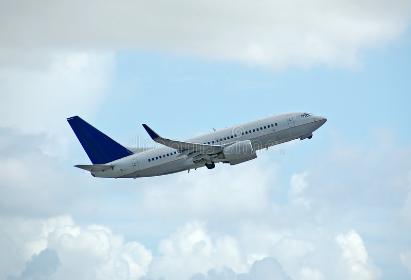 Boeing 737 jetliner taking off royalty free stock photos