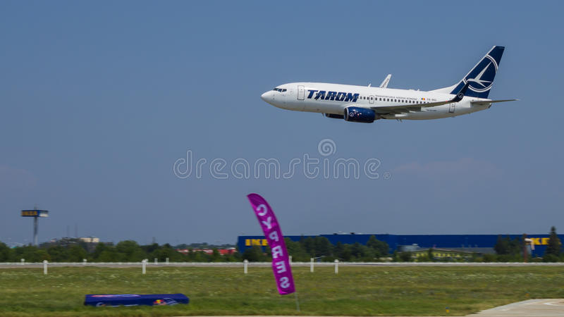 Boeing 737 YR-BGI from TAROM. Boeing 737 from TAROM during flight demonstration at Bucharest International Air Show 2013 royalty free stock photos