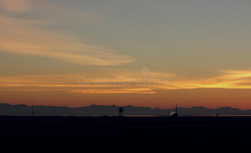 Boeing 747 against Sunset royalty free stock images