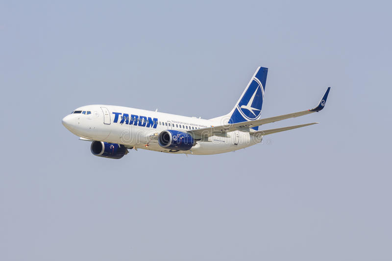 Boeing 737 airliner. Boeing 737 of TAROM company climbs after take off on July 27, 2013 in Bucharest, Romania. TAROM owns one of the youngest fleet in Europe stock photography