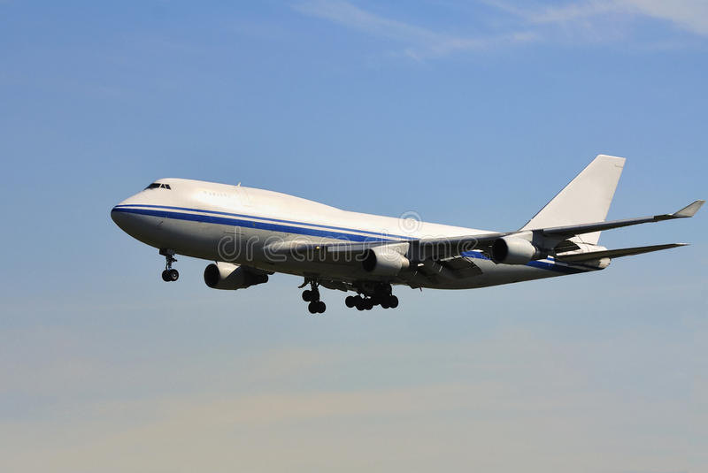 Plane. Boeing air plane flying in blue sky stock images