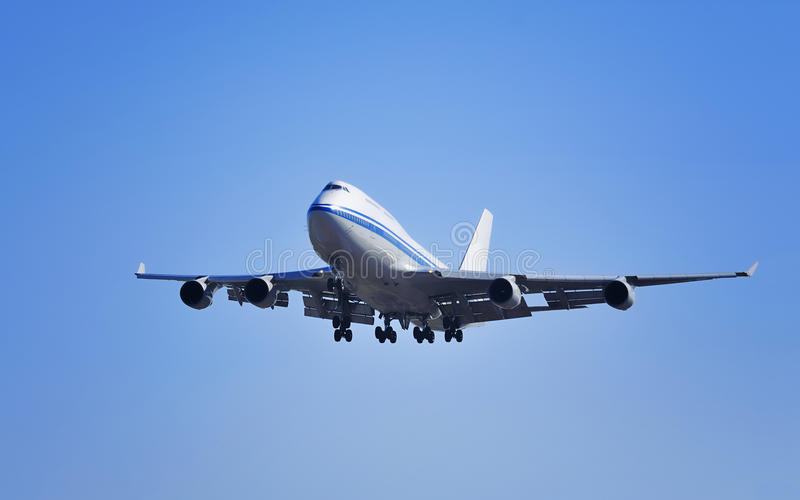 Air plane. Boeing airplane flying in blue sky stock images