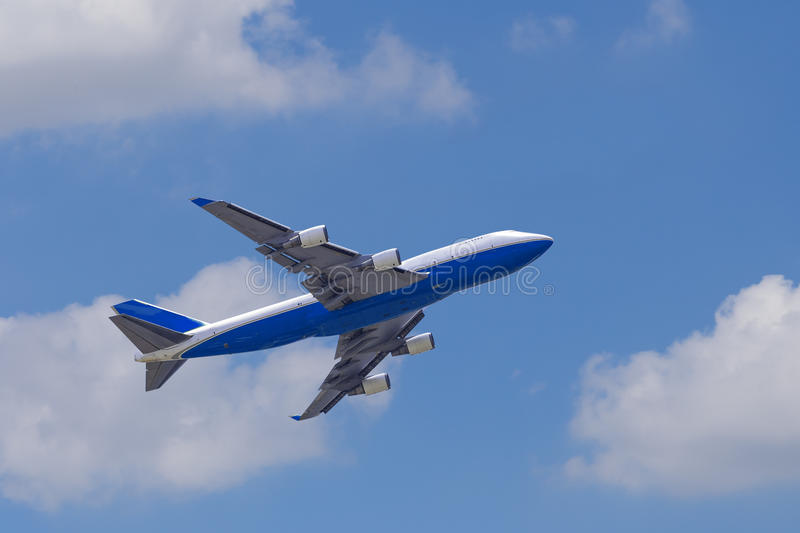 Boeing 747-400 airplane againt blue sky. After take off royalty free stock image