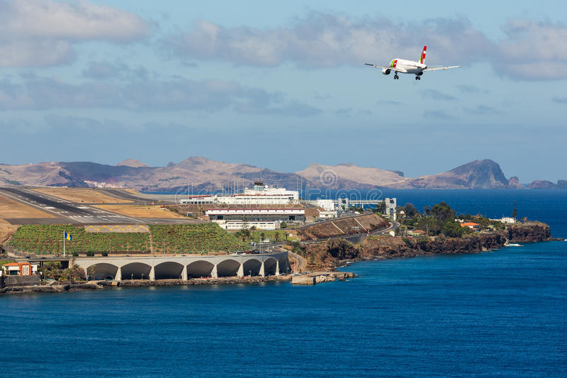 Boeing 737 is approaching Funchal Airport at Madeira, Portugal. FUNCHAL, PORTUGAL - AUG 12: A Boeing 737 from Portugese airline TAP is approaching Funchal royalty free stock images