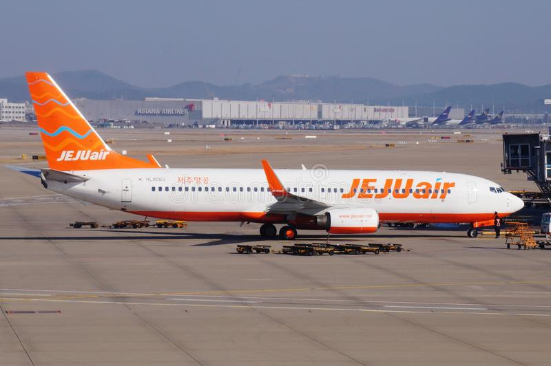 A Boeing 737-8AS airplane from Korean low-cost airline Jeju Air 7C. INCHEON, SOUTH KOREA -A Boeing 737-8AS airplane from Korean low-cost airline Jeju Air 7C on stock image