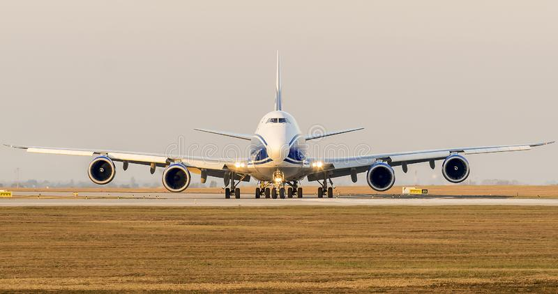 Boeing B747 airplane is taxiing to runway for takeoff royalty free stock image