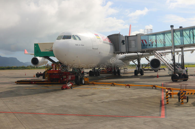 The Boeing B777 300/200 LR Air Mauritius. Maintainance unit preparing Boeing B777 300/200 LR Air Mauritius for flight on SSR International Airport,Mauritius royalty free stock photography