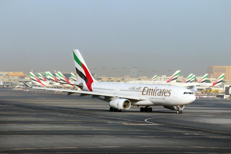 The Boeing B777 300/200 LR Emirates. The Boeing B777 300/200 LR Emirates take off on Dubai International Airport. Modern jet aircraft for 550 passengers royalty free stock images