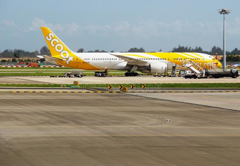 A Boeing 787 Dreamliner from Scoot (TZ). CHANGI, SINGAPORE - A Boeing 787 Dreamliner from Scoot (TZ), a low-cost long-haul airline owned by Singapore Airlines stock photography