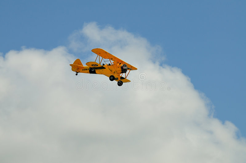 Boeing E75 Biplane. A Boeing Stearman E75 Biplane in US Navy markings flies over Punta Gorda Florida as part of an airshow royalty free stock photography