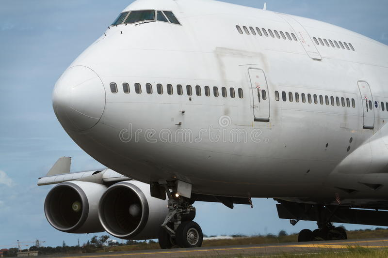 Boeing 747 jumbo jet close up. Boeing 747 jumbo jet front view close up stock image