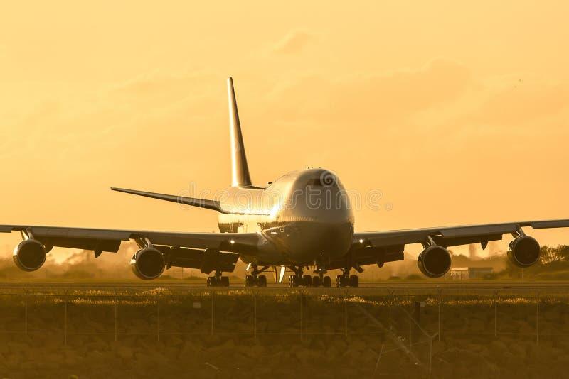 Boeing 747 jumbo jet morning light. Boeing 747 jumbo jet in morning low light stock image