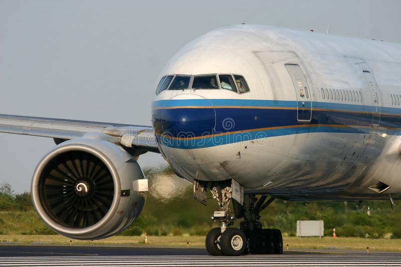 Boeing 777 lining up on the runway stock photos