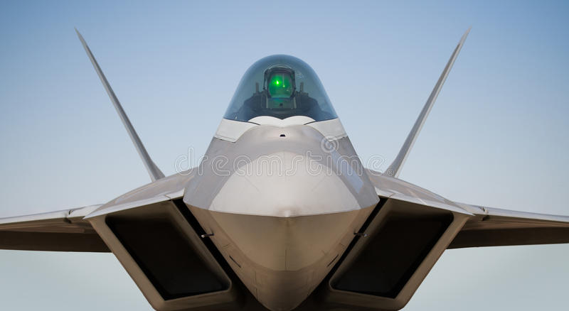 Boeing/Lockheed F-22 Raptor. A Boeing/Lockheed F-22 Raptor against a blue sky stock photo