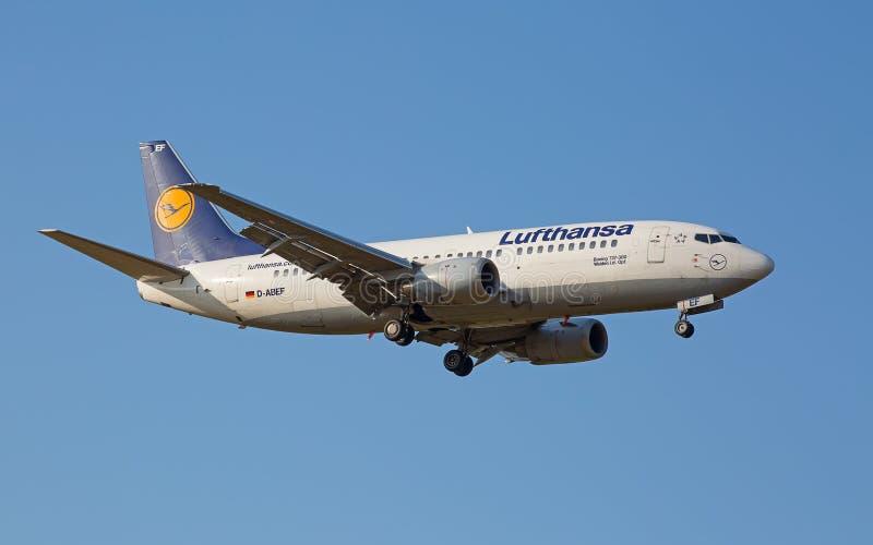 Boeing-737 Lufthansa. ZURICH - JULY 18: Boeing-737 Lufthansa landing in Zurich after short haul flight on July 18, 2015 in Zurich, Switzerland. Zurich airport is royalty free stock images