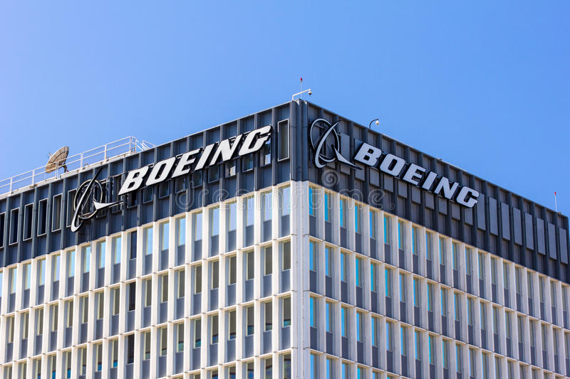 Boeing Manufacturing Facility and Logo. EL SEGUNDO, CA/USA - MARCH 7, 2015: Boeing manufactuing facility. Boeing manufactures and sells aircraft, rotorcraft stock photos