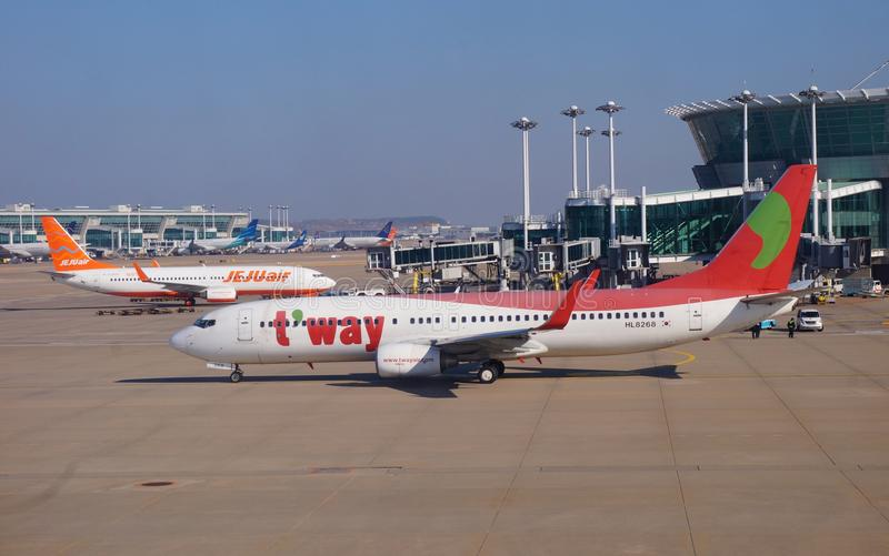 A Boeing 737-83N airplane from Korean low-cost airline TWay TW. INCHEON, SOUTH KOREA - A Boeing 737-83N airplane from Korean low-cost airline TWay TW on the stock images