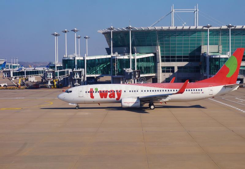 A Boeing 737-83N airplane from Korean low-cost airline TWay TW. INCHEON, SOUTH KOREA - A Boeing 737-83N airplane from Korean low-cost airline TWay TW on the royalty free stock images