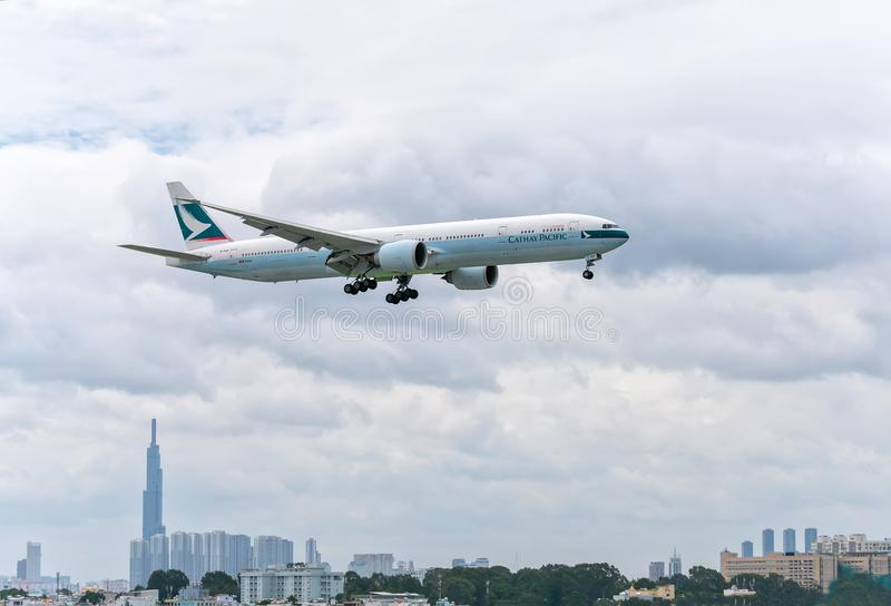 Boeing 777 passenger aircraft of airline Cathay Pacific is preparing to land at Tan Son Nhat International Airport stock photography