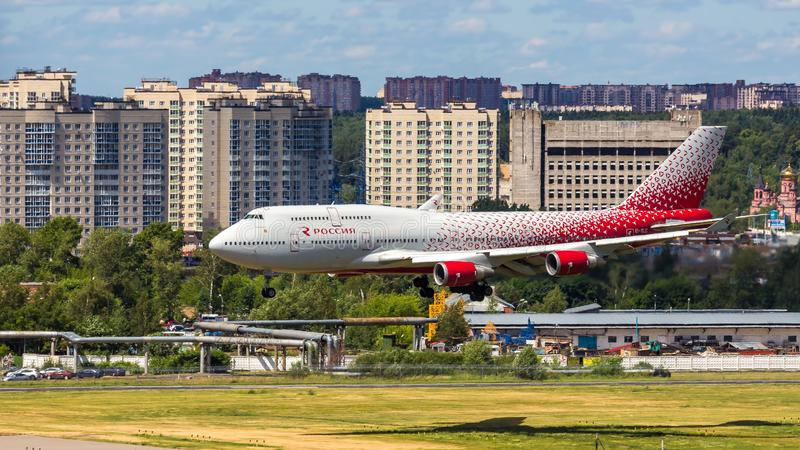 Moscow,Russia-07/02/2018:The passenger plane lands at Vnukovo International Airport VKO in Moscow. Boeing 747 registration number EI-XLC, Rossiya airlines lands royalty free stock photography
