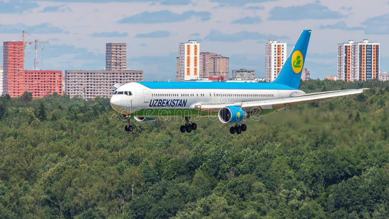 Moscow,Russia-07/02/2018:The passenger plane lands at Vnukovo International Airport VKO in Moscow. Boeing 767 registration number UK67003, Uzbekistan Airways stock photography