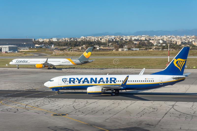 Boeing 737-800 Ryanair airlines and boeing 757 Condor Thomas cook, airport Luqa Malta, 28 April 2019.  royalty free stock photography