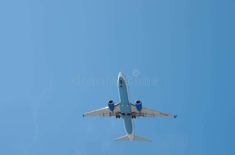Boeing 737-800. Sochi, Russia - June 11: Aircraft Boeing 737-800, operated by Pobeda, landing in airport of Sochi, on June 11, 2015 in Sochi royalty free stock image