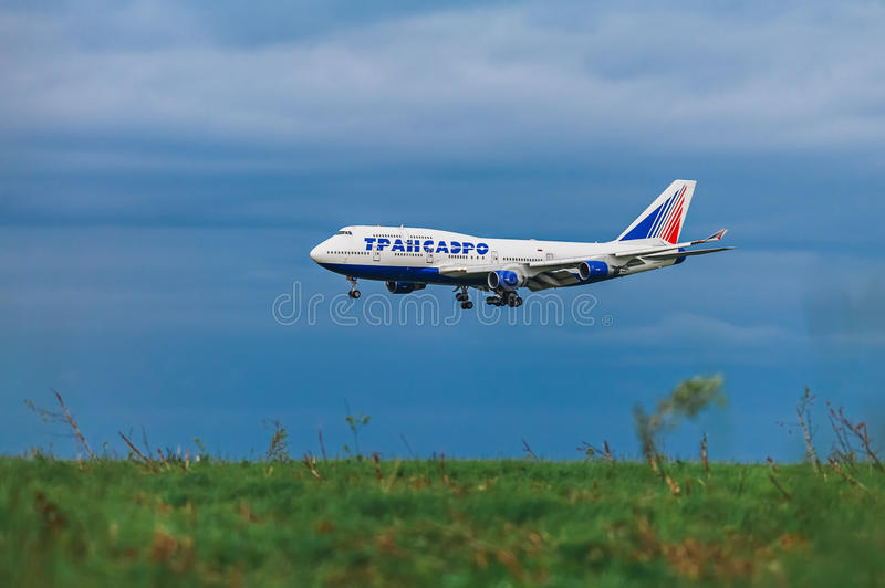 Boeing 747-400 Transaero Airlines on the background of storm clouds. At Moscow Airport Domodedovo royalty free stock photo