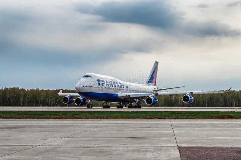 Boeing 747-400 Transaero Airlines is taxing the runway at the airport. At the Moscow airport Domodedovo stock image