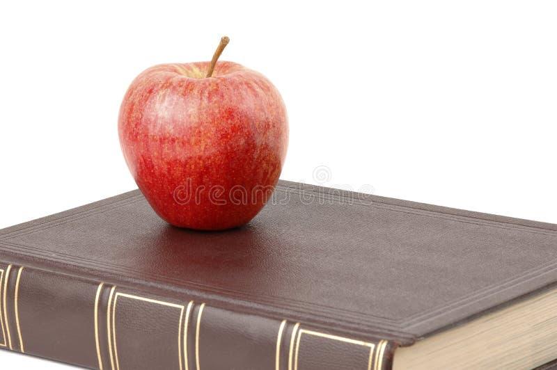 Boek en Apple stock foto's