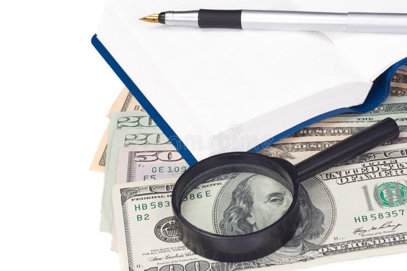 Boek en contant geld van dollars stock fotografie