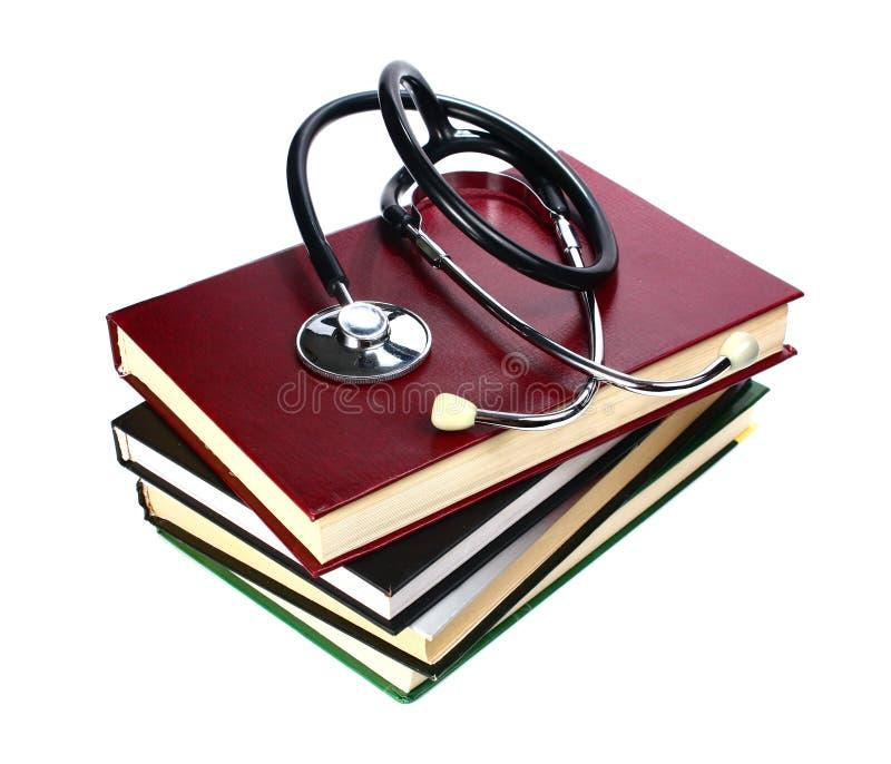 Boek en stethoscoop royalty-vrije stock afbeeldingen