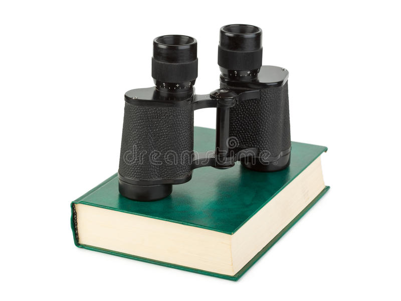 Boek en verrekijkers stock fotografie