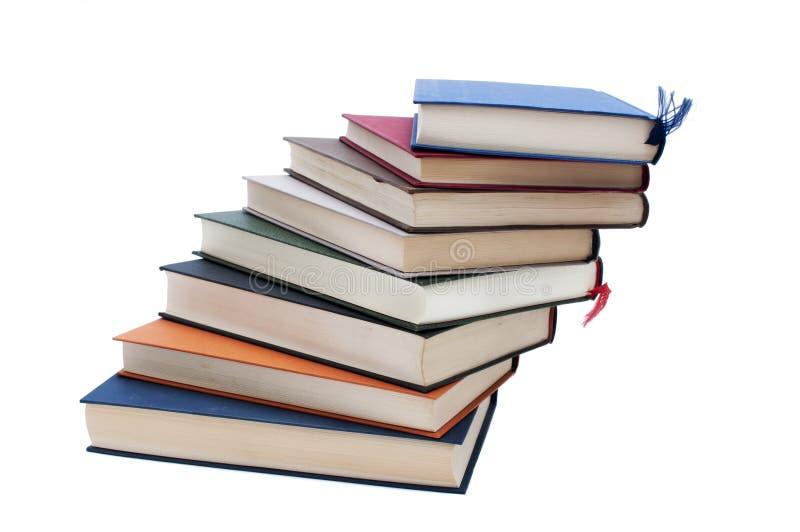 Boeken die in een spiraal worden gestapeld stock foto's
